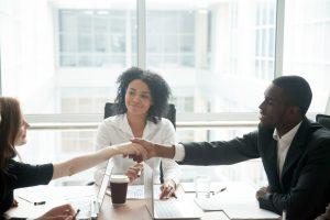 diverse agm meeting handshake
